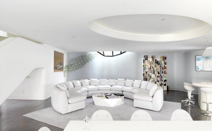 Rounded white leather sofa in a Luxury White Two-Storey House in Los Angeles, California