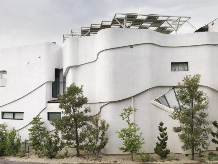 Solar panels situated in the rooftop terrace of a Luxury White Two-Storey House in Los Angeles, California