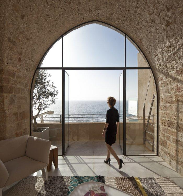 Stone arch wide window in a Spectacular Ancient Seaside Penthouse in Tel Aviv