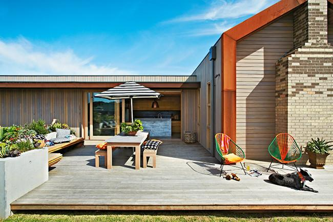 Sunny patio with comfortable furniture and colorful chairs - 8 Interesting Decoration Ideas