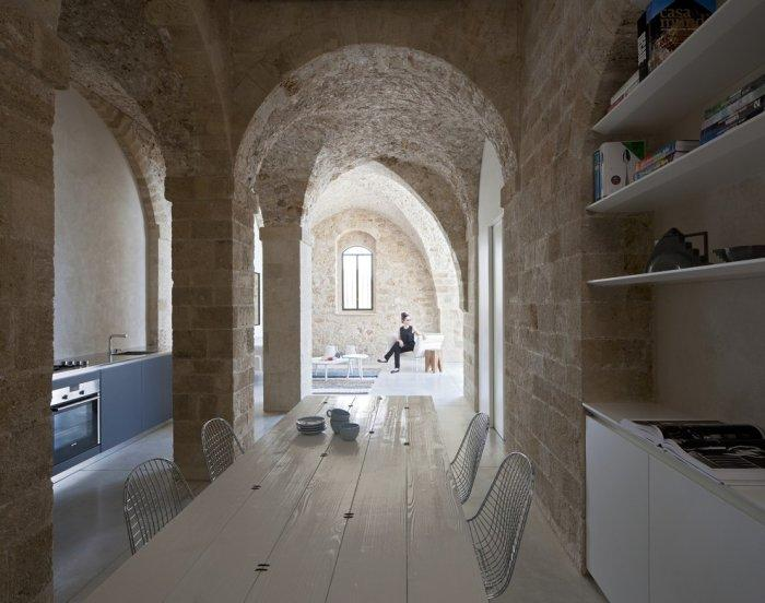 The dining table in the penthouse - Spectacular Ancient Seaside Penthouse in Tel Aviv
