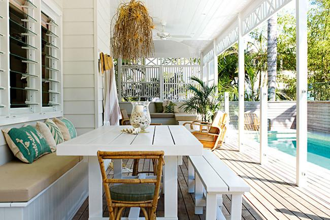 White patio furniture placed on a wooden deck - 8 Interesting Decoration Ideas