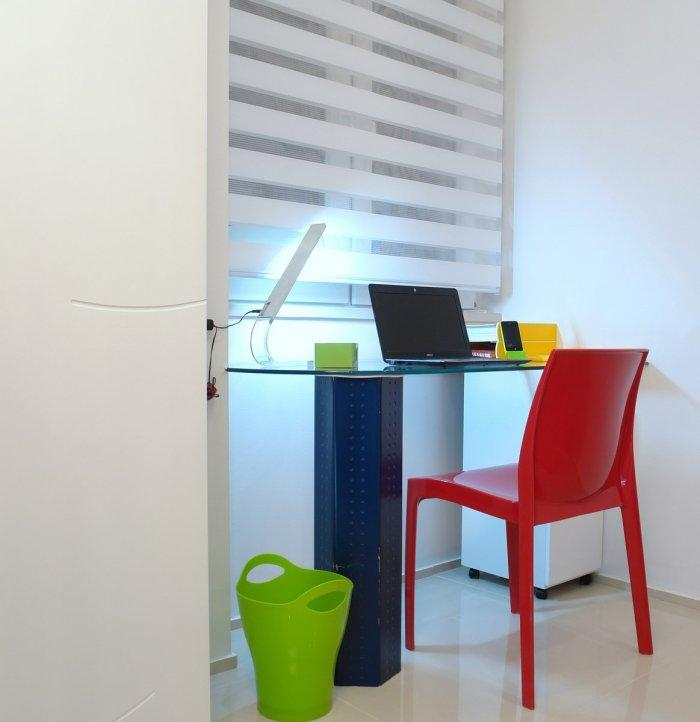 Working home desk with colorful chair and accessories - a Family Apartment in Budapest