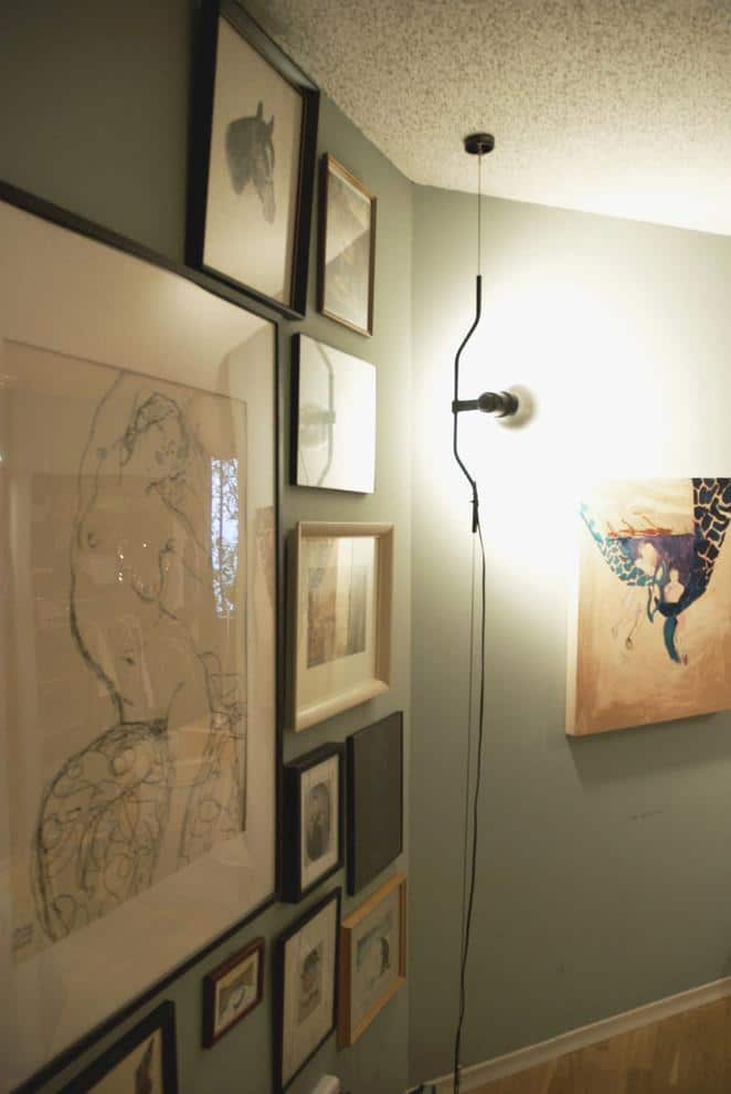 Parentesi lamp and a collection of different wall framed pictures - Loft in Vancouver with Vintage and Classic Touch