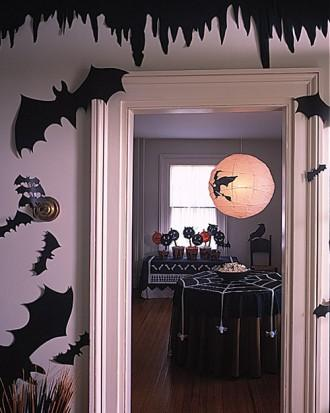Spiderweb Tablecloth with Pom-Pom Spiders - 34 Ideas for Halloween Table Decorations - How To