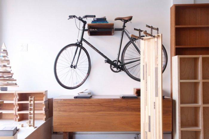 Bicycle placed on a wall bike holder - Living in a Romantic Apartment in Montreal