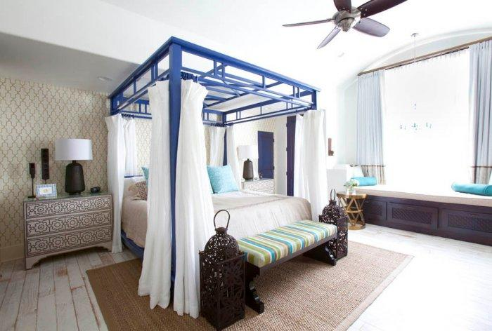 Blue Mediterranean canopy bed with white bedsheets - The bedroom furniture of you dreams