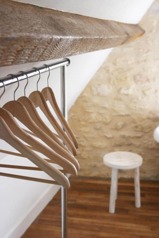 Coat hangers in a rustic corner - La Maisonnette - A Romantic French Cottage