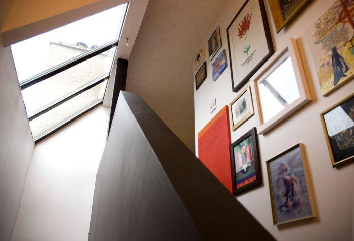 Colorful collection of illustrations decorate the staircase - Loft in Vancouver with Vintage and Classic Touch