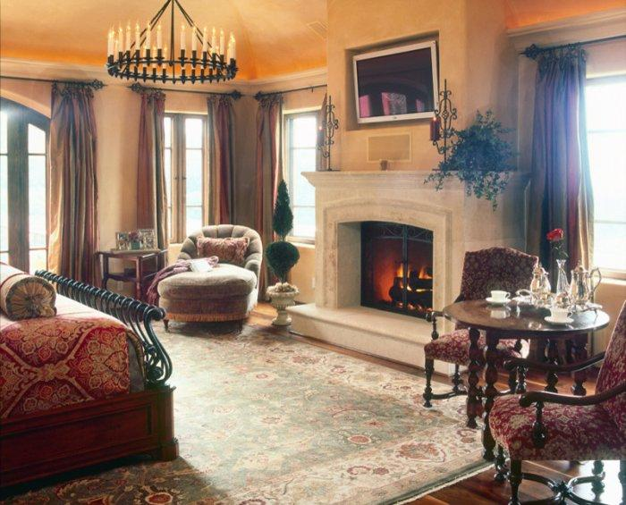 Cozy Bedroom With A Fireplace, Club Chairs And Antique Table And Bed   Inspiring Furniture