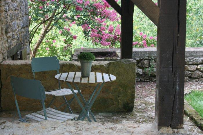 Cozy outdoor little coffee table with a pair of chairs - La Maisonnette - A Romantic French Cottage