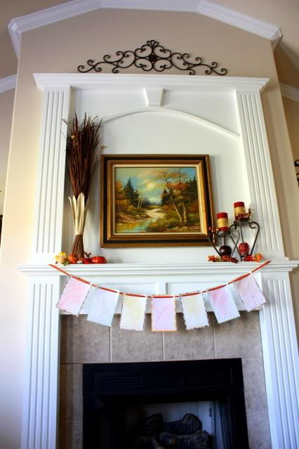 Creative autumn garland placed at the fireplace - 9 Easy DIY Decorating Ideas with Leaves