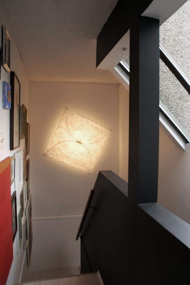 Eclectic ambient lamp placed at the staircase - Loft in Vancouver with Vintage and Classic Touch