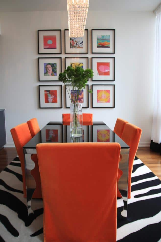 Eclectic dining room design with orange accents - Beautiful Apartment in Manhattan, New York