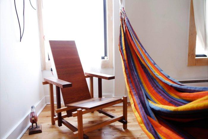 Hand-made wooden armchair and a colorful hammock - Living in a Romantic Apartment in Montreal