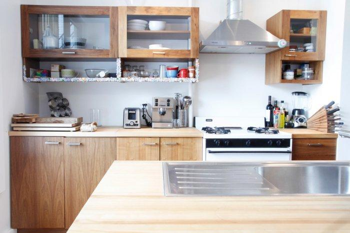 Modern kitchen appliances and cabinets - Living in a Romantic Apartment in Montreal