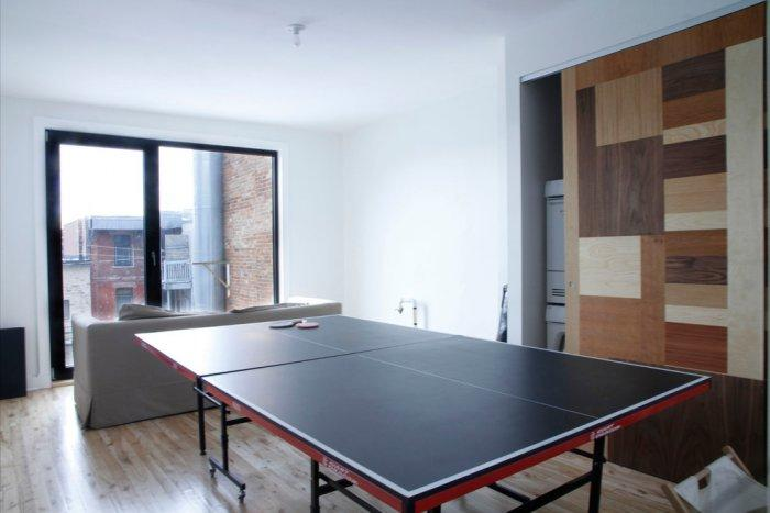 Playing room with various games - Living in a Romantic Apartment in Montreal