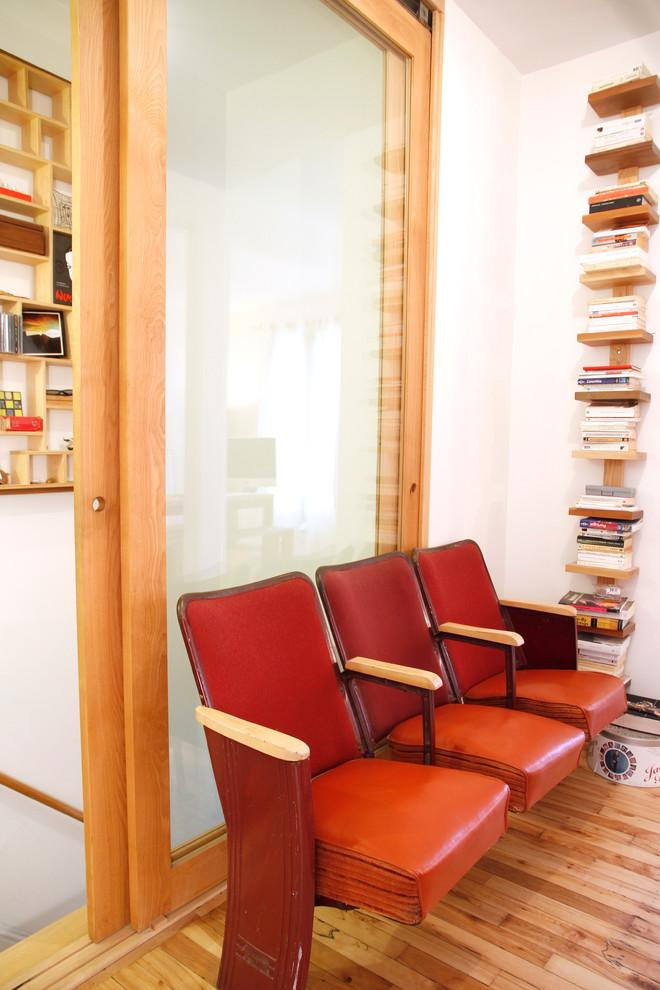Reading corner with antique theater seats and wooden bookshelves - Living in a Romantic Apartment in Montreal