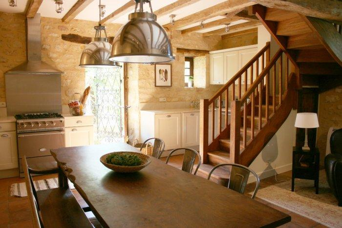 Rustic French kitchen with contemporary lighting - La Maisonnette - A Romantic French Cottage