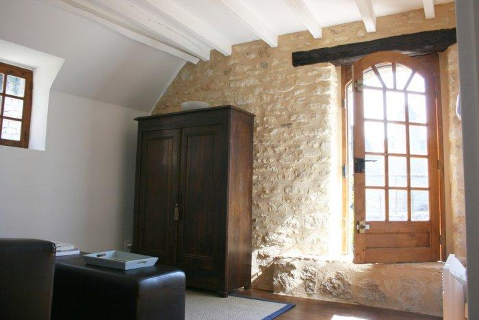 Solid wooden wardrobe in a rustic room - La Maisonnette - A Romantic French Cottage
