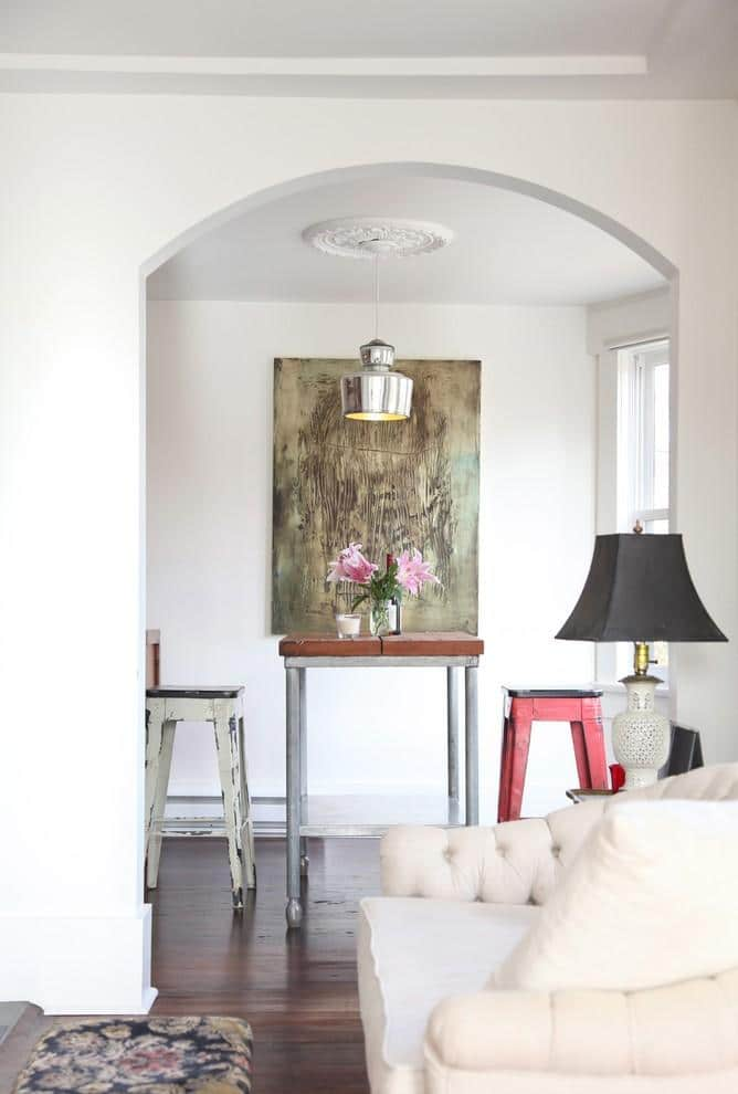 Stylish small dining area with abstract wall artwork- Two eclectic apartments in Vancouver