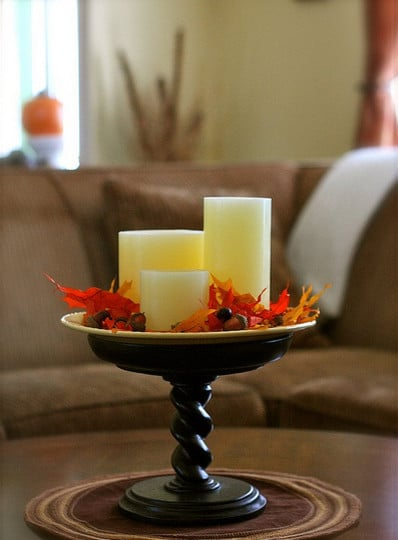 Table centerpiece full of autumn leaves and electric candles - 9 Easy DIY Decorating Ideas