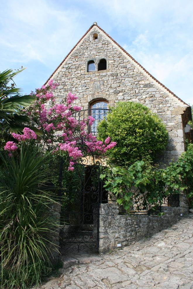 The main entrance of the rustic cottage - La Maisonnette - A Romantic French Cottage