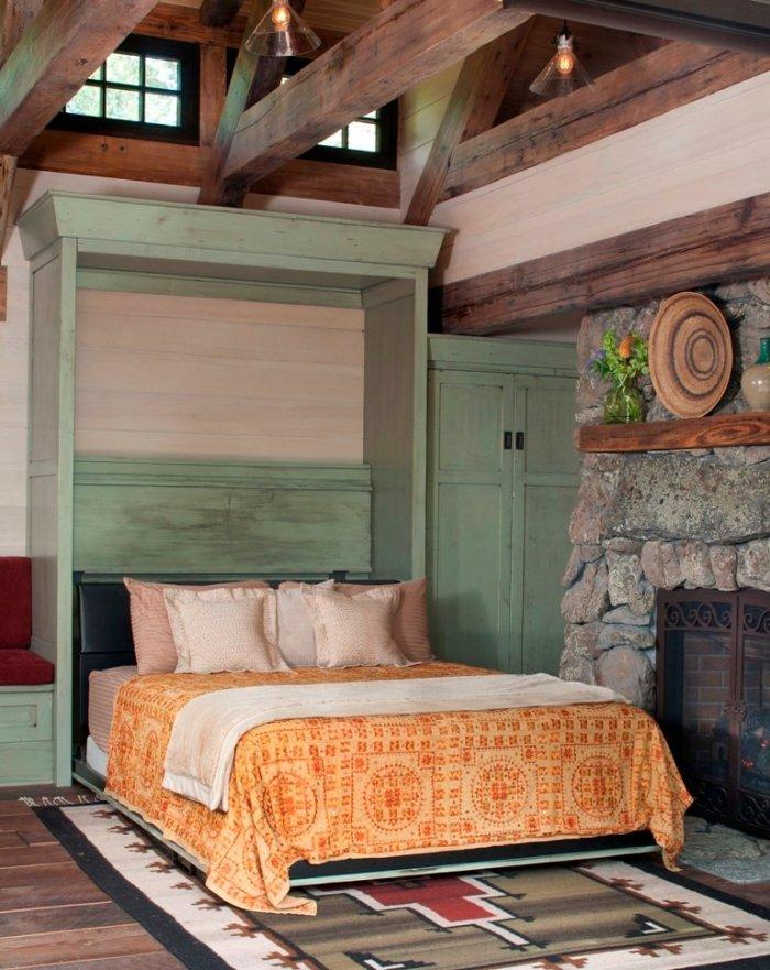 Murphy bed in a rustic mountain cottage near Rocky Mountains, Colorado