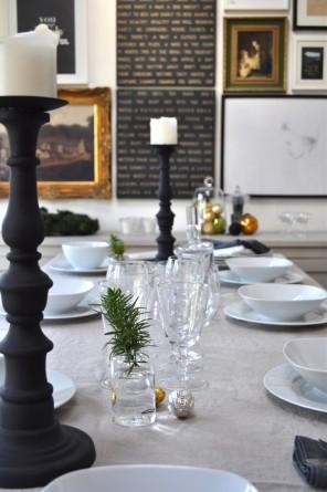 A Christmas table decorated with tree branches, silver balls and candleholders - 17 Scandinavian Examples of Home Decorations