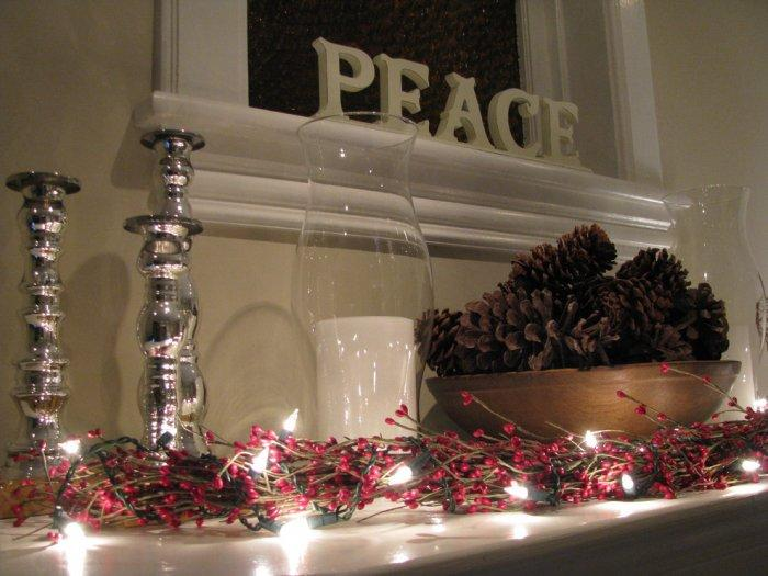 A garland of red berries and lights - 10 Simple and Elegant Christmas Decorating Ideas
