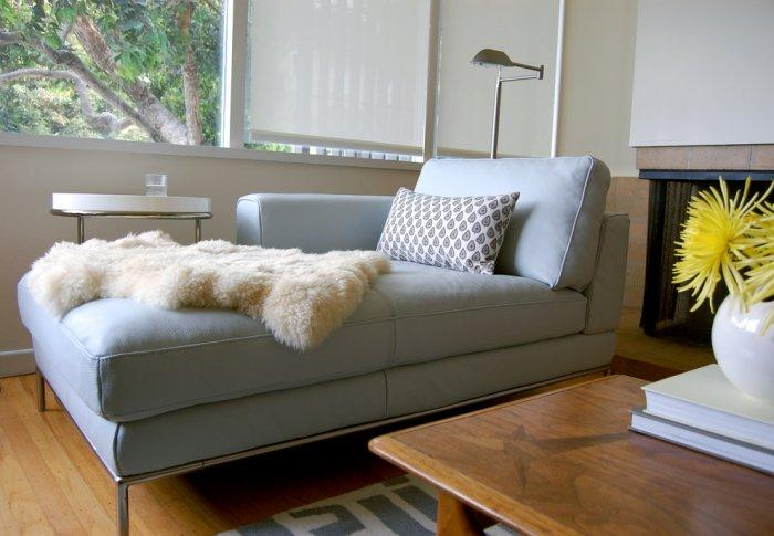 A sheepskin placed on a stylish sofa - 17 Scandinavian Examples of Home Decorations