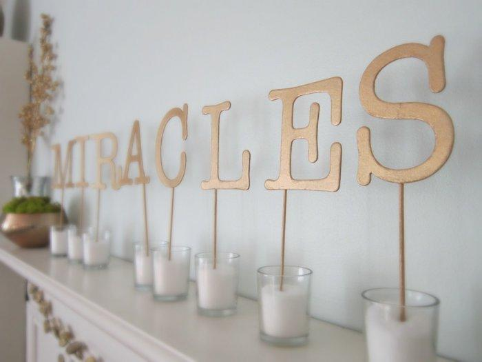 Creative budget decoration idea for Christmas with craft store letters, gold paint and skewers