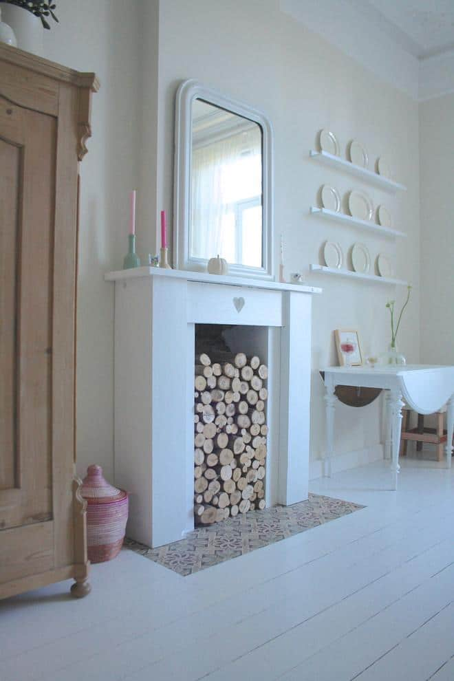 Cut wood placed in a decorative fireplace - 17 Scandinavian Examples of Home Decorations