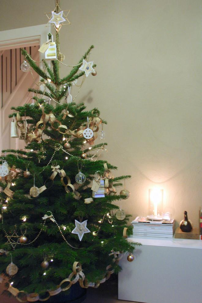A Christmas tree with Lovely Hand-crafted Paper Decorations