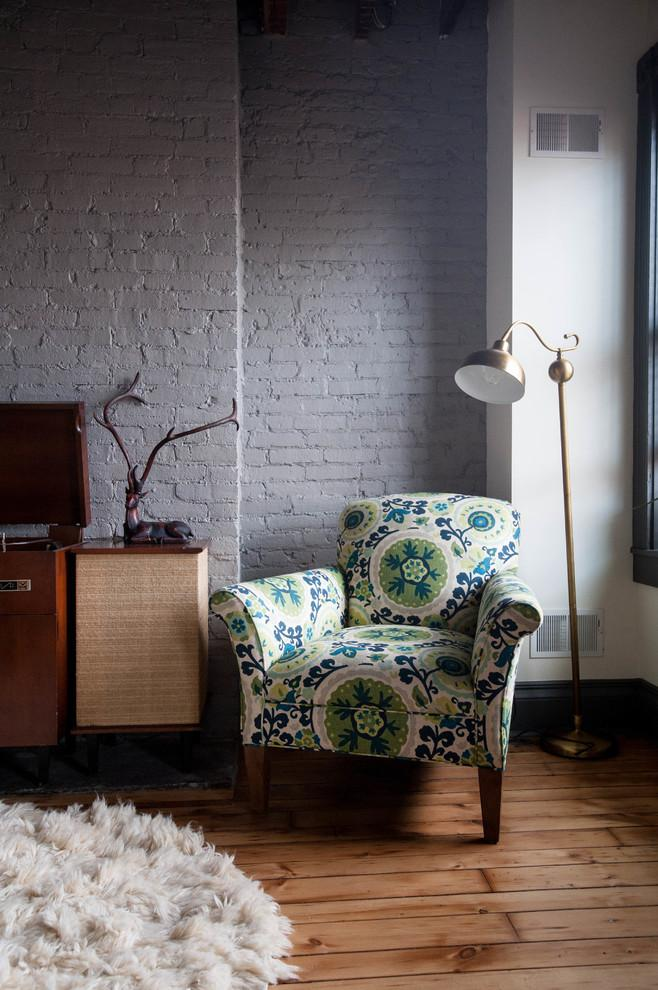 Eclectic armchair with stylish green upholstery - Magical Couple Home in Pittsburgh, USA