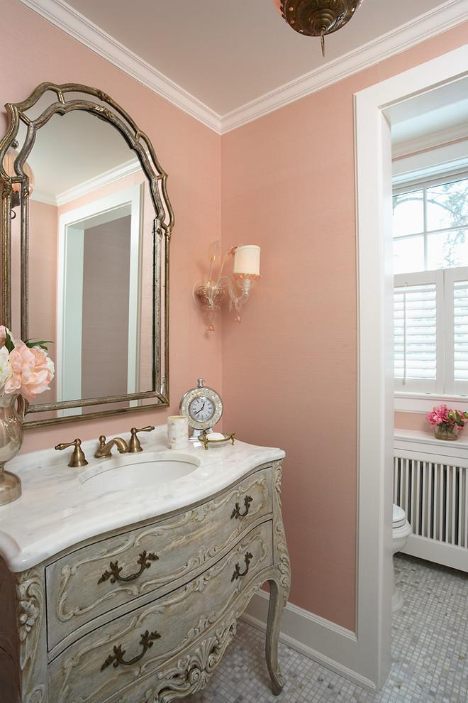 Feminine pink powder room with a classic French vanity - Stunning Family Mansion in Minnesota
