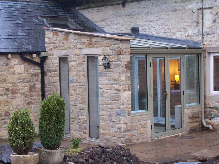 House entrance with stone cladding - Benefits of your bespoke conservatory