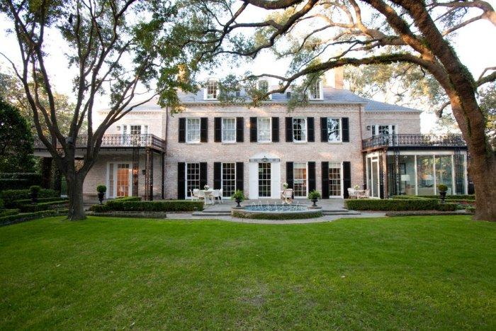 A front lawn and a small fountain in a Refined Mansion with Elegant Touch in Houston