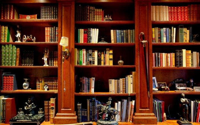 Luxury wooden library shelving with French Calvary decorations - Mansion in California in Italian Style
