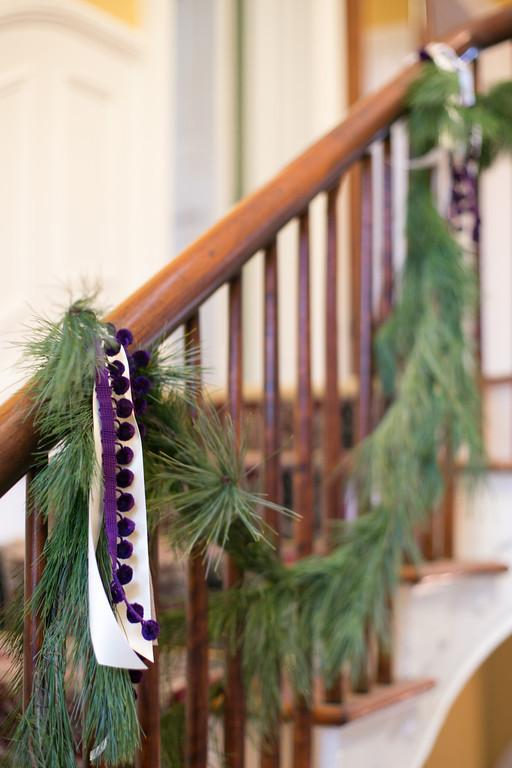 Natural green Christmas garland tied to a banister - Simple and Elegant Budget Decorating Ideas
