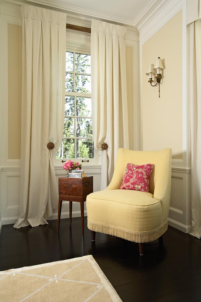 Pale yellow upholstered armchair and beige curtains - Stunning Family Mansion in Minnesota