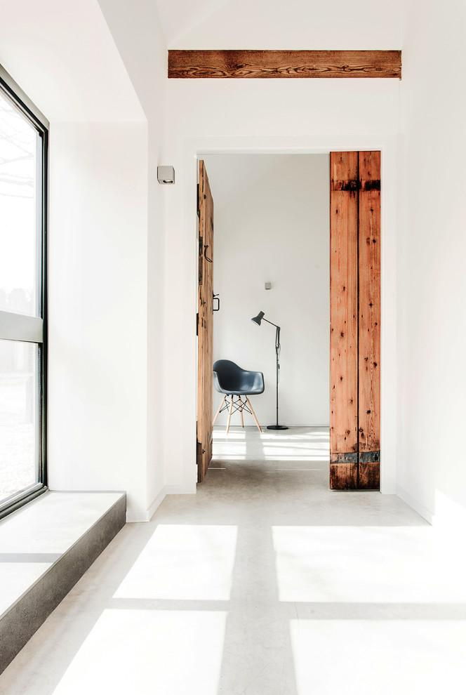 Polished concrete floor with radiant heating - Old English Stable turned into Minimalist Guesthouse