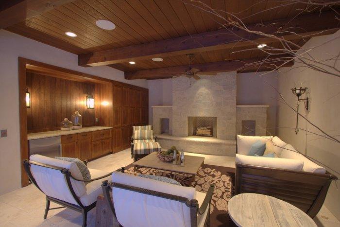 Poolside cabana with tavertine floor and limestone fireplace - Splendid High-End Mansion in Minnesota, USA