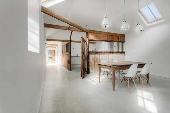 Rustic dining room with contemporary Eames chairs - Old English Stable turned into Minimalist Guesthouse