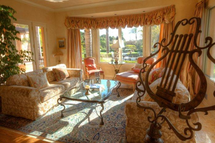 sunny-family-room-with-classic-furniture-in-warm-tones
