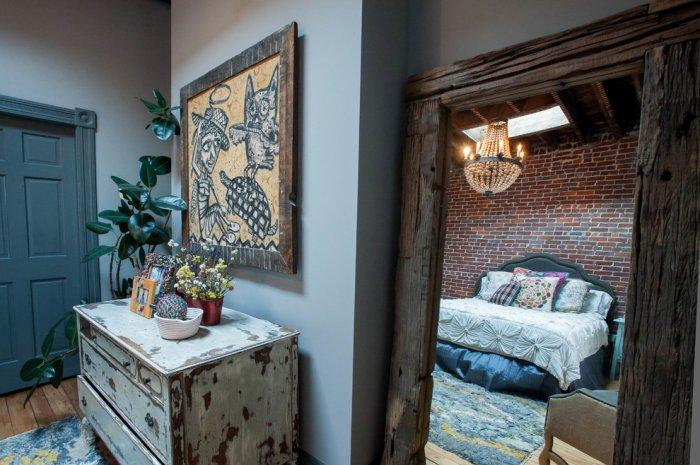 The reclaimed wood framed door to an eclectic bedroom - Magical Couple Home in Pittsburgh, USA