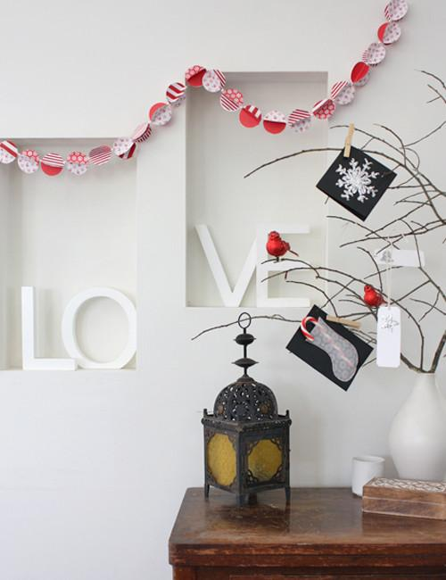Tree branches decorated in lovely red ornaments and cards - 17 Scandinavian Examples of Home Decorations
