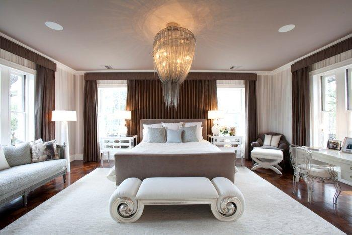 Ultra luxury classic bedroom with beautiful crystal chandelier and cozy bed setting - Refined Mansion with Elegant Touch in Houston