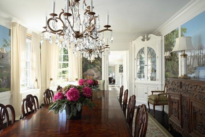 Ultra luxury classic dinner room with wooden table and chairs and crystal chandeliers - Stunning Family Mansion in Minnesota