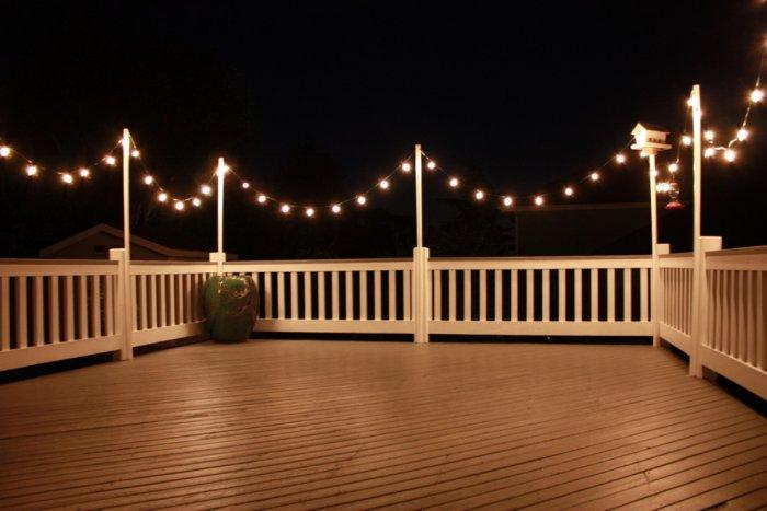 Christmas lights at the front wooden deck - Casual Christmas Decoration